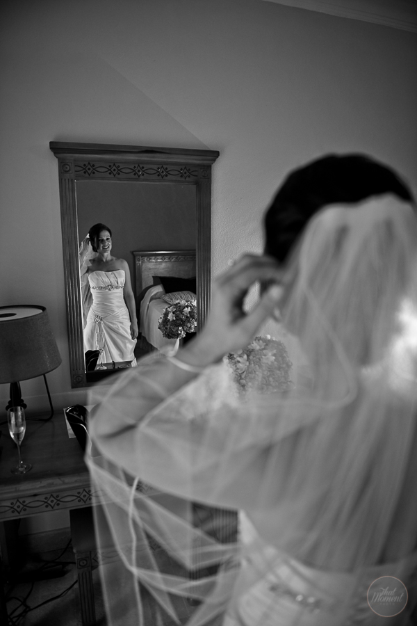 the bride dresses before the mirror