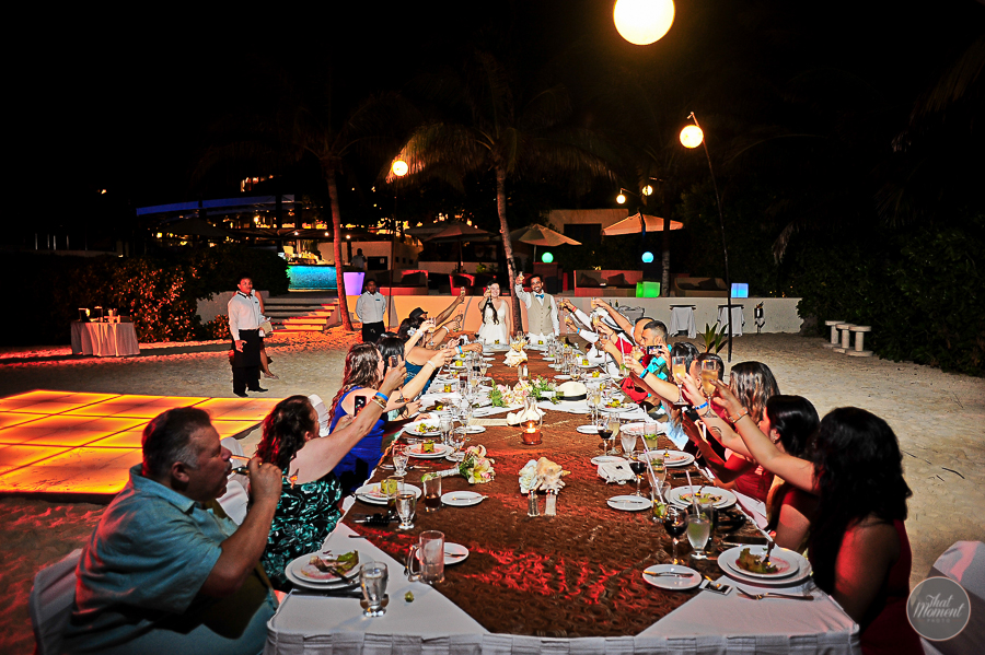 the couple having dinner whit the family on the beach