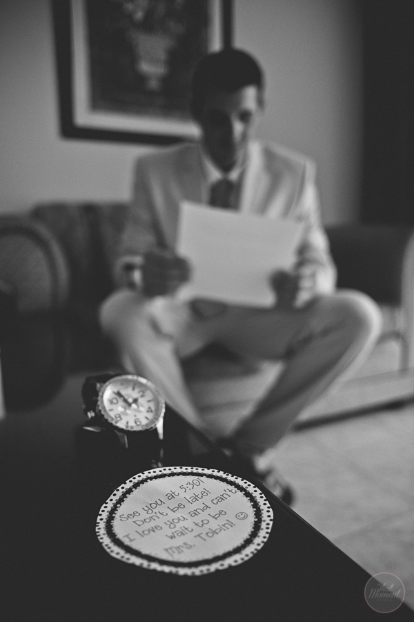 groom shows his watch