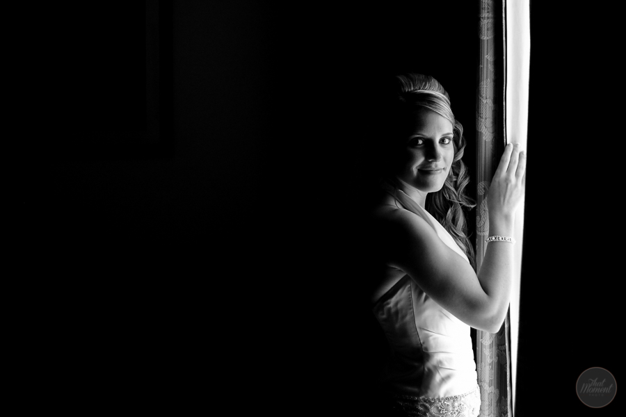 Bride looks through the window