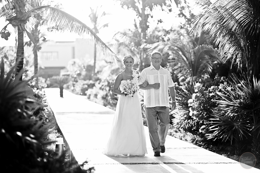 the bride walking to the ceremony with his father