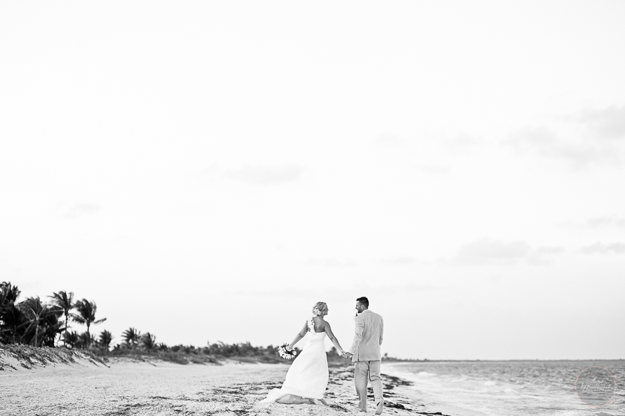 the couple walking on the beach