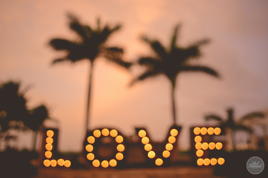 neon sign with the word love