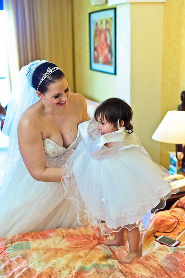 bride putting her baby dress for wedding