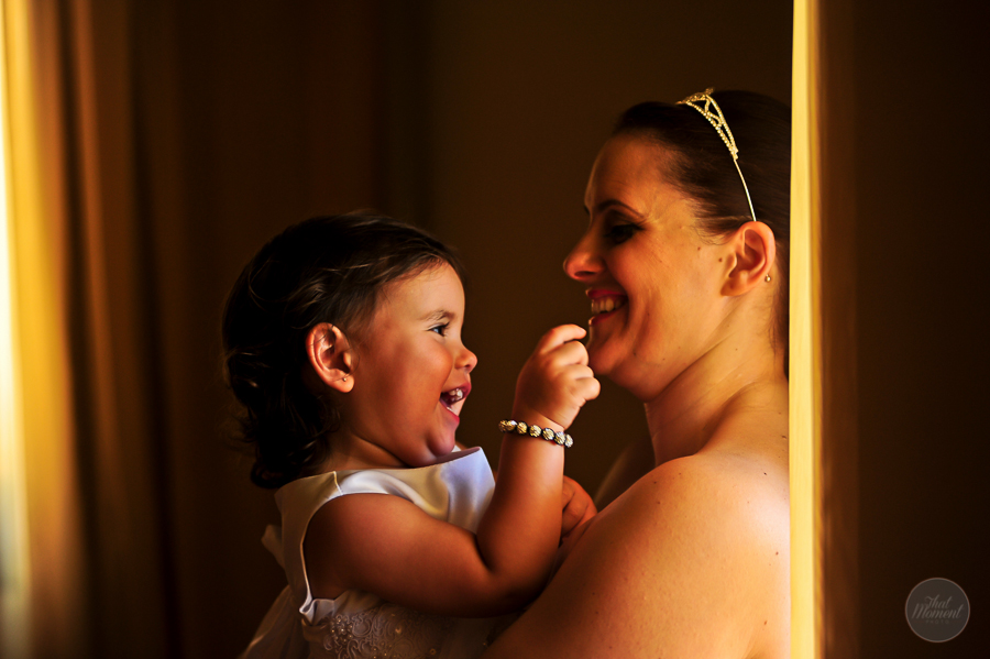 laughing bride with her baby